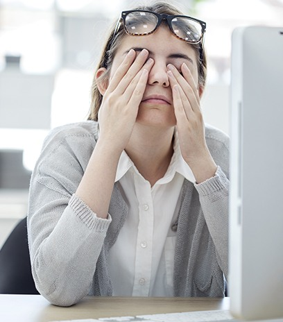 Woman with eye pain from staring at computer