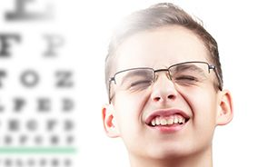 Teen with glasses squinting to see