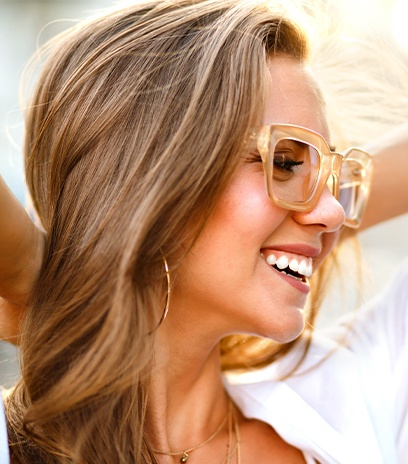 Smiling woman with plastic frame glasses