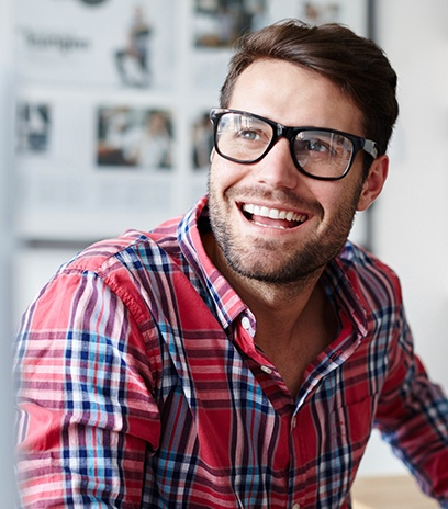 Man wearing eyeglasses with treated lenses