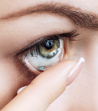 Woman placing scleral lenses